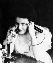 woman using candlestick phone
